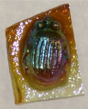 (13260) SMALL SCARAB-LT AMBER